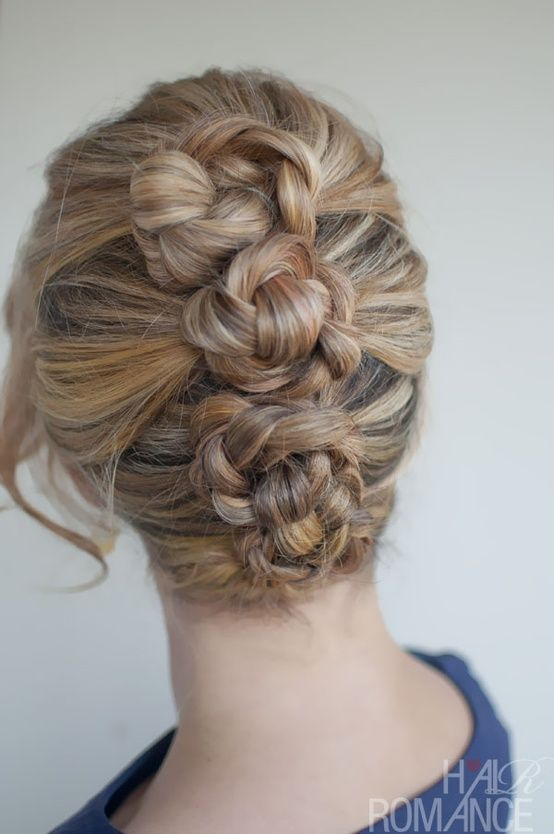 Another variation on the mini-bun. Here, you make three ponytails, braid them, t...