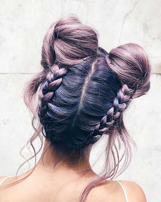 Braids and buns are two hairstyles that, on their own, will probably never go ou...