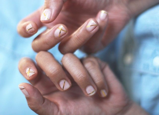 Gold-striped nails. You won't believe how easy this is. Click on the photo...
