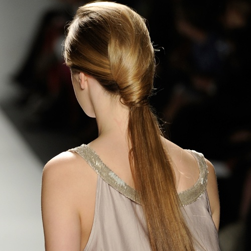 Love this sophisticated wrapped ponytail (The Pony Loops at Son Jung Wan).