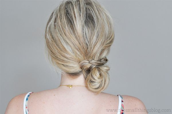 Sweep your hair off your neck into this easy but pretty bun.
