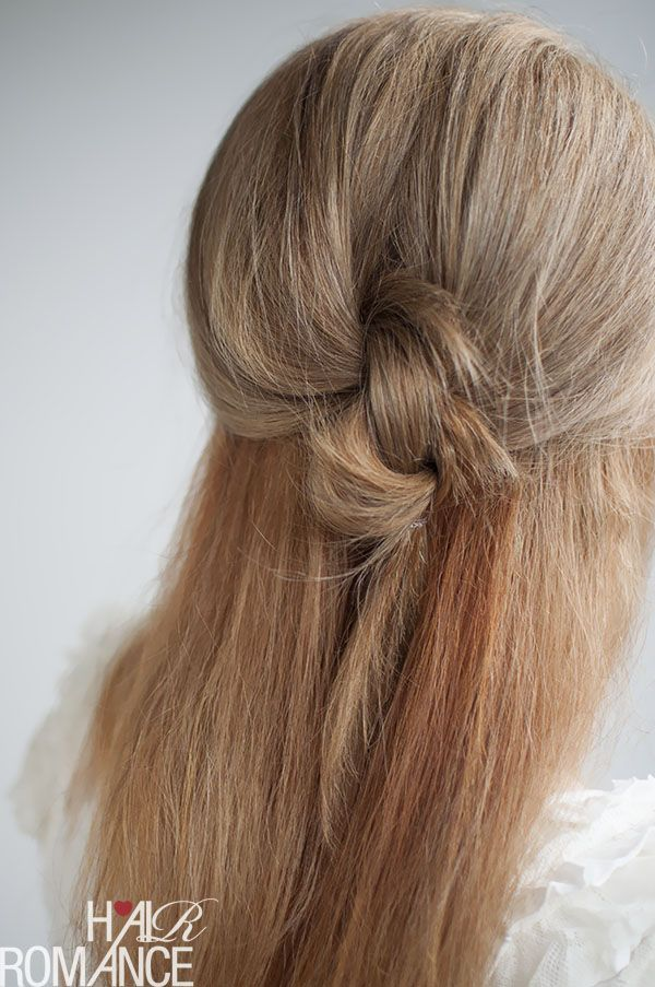 This half-up knotted style works for both straight and curly hair. Get the how-t...