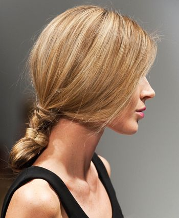 To get this simple, feminine style, just make a low ponytail, then twist it back...