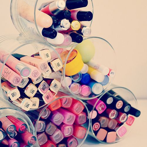 Cool diy for all my lip products!!! I'm guessing you just hot glue gun them ...