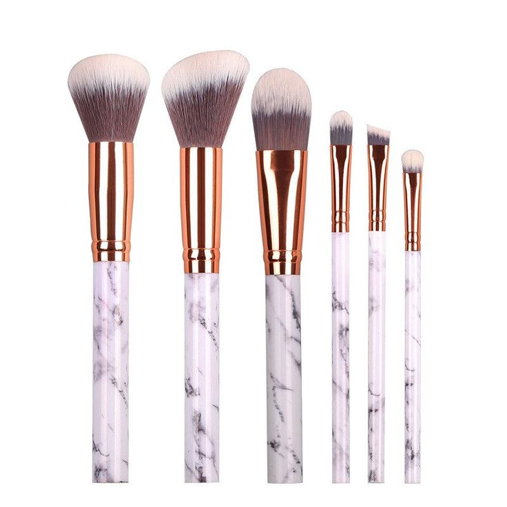 Our magical white marble and gold makeup brush set include 6 different brushes. ...