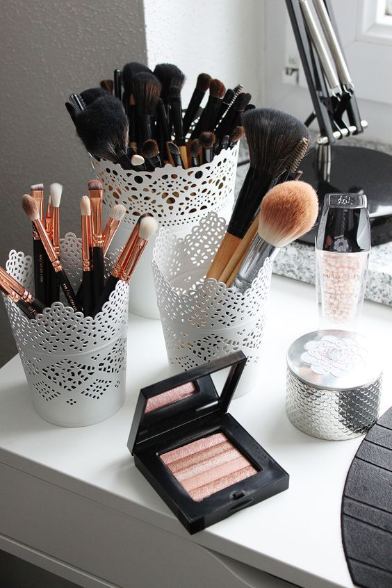 These cute metal canisters make great storage for makeup brushes at your vanity.