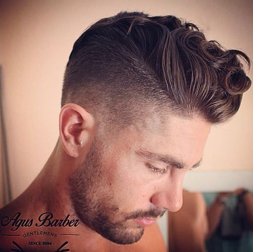 curly pompadour hairstyle for men...