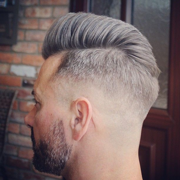 Medium faded #pompador style, slightly split and blown high and the front and lo...