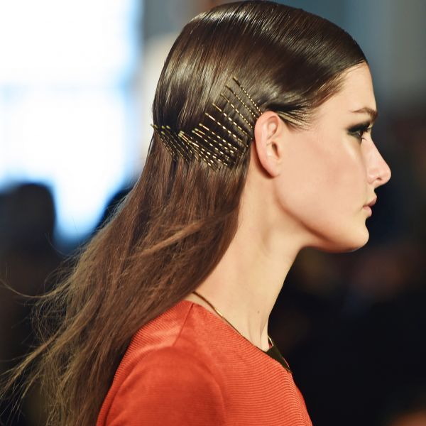 Create a deep side part and slick hair straight down with a shine pomade. Starti...