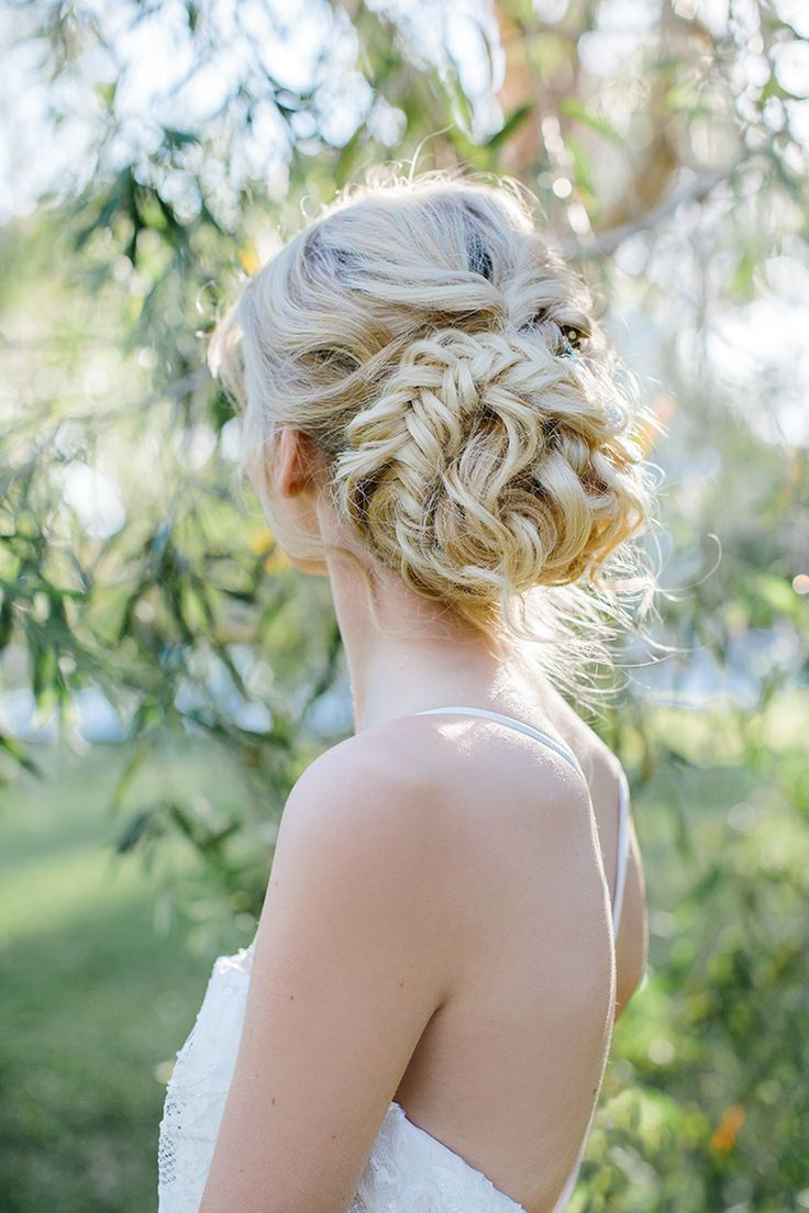 Romantic braided low bun wedding hairstyle | Camilla Kirk Photography
