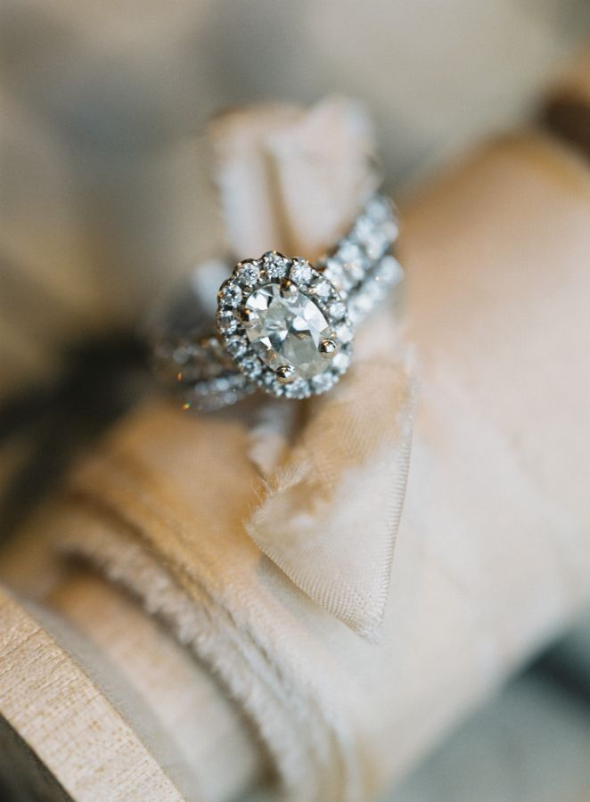 Beautiful oval cut halo engagement ring: www.stylemepretty... | Photography: Bre...