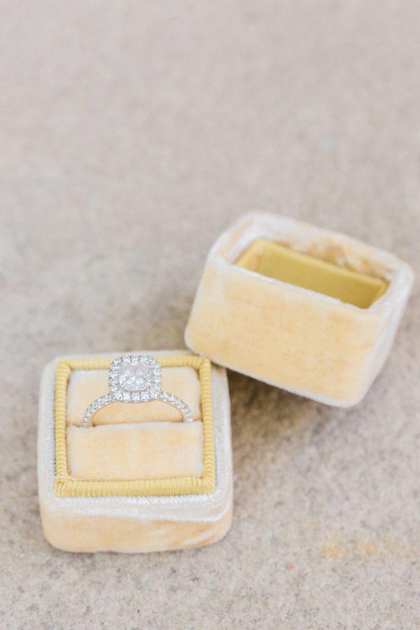 Dazzling cushion cut halo engagement ring: www.stylemepretty... | Photography: K...