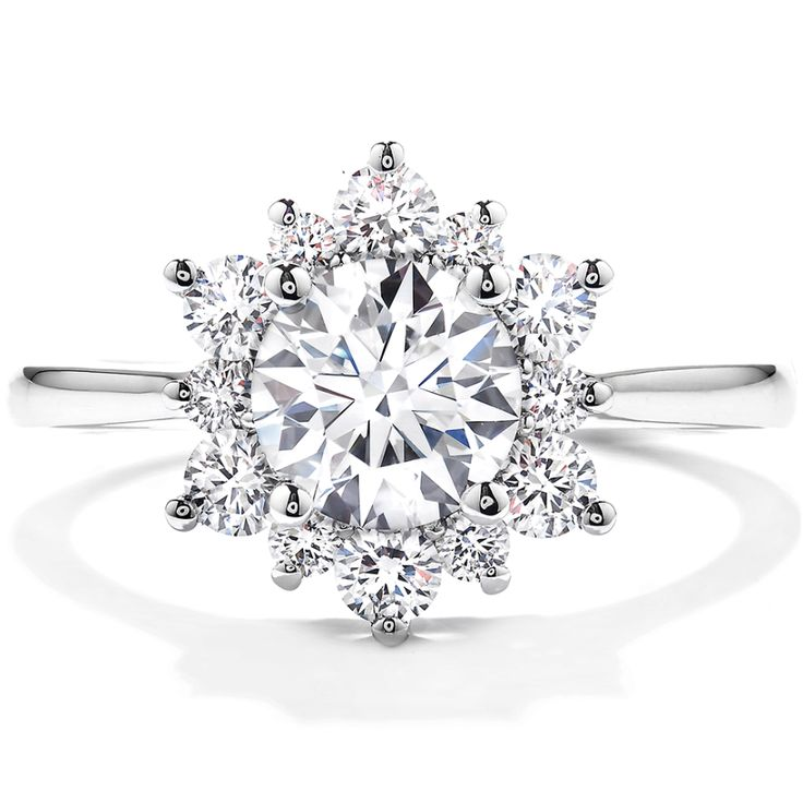 Dazzling Hearts On Fire diamond engagement ring: www.stylemepretty...