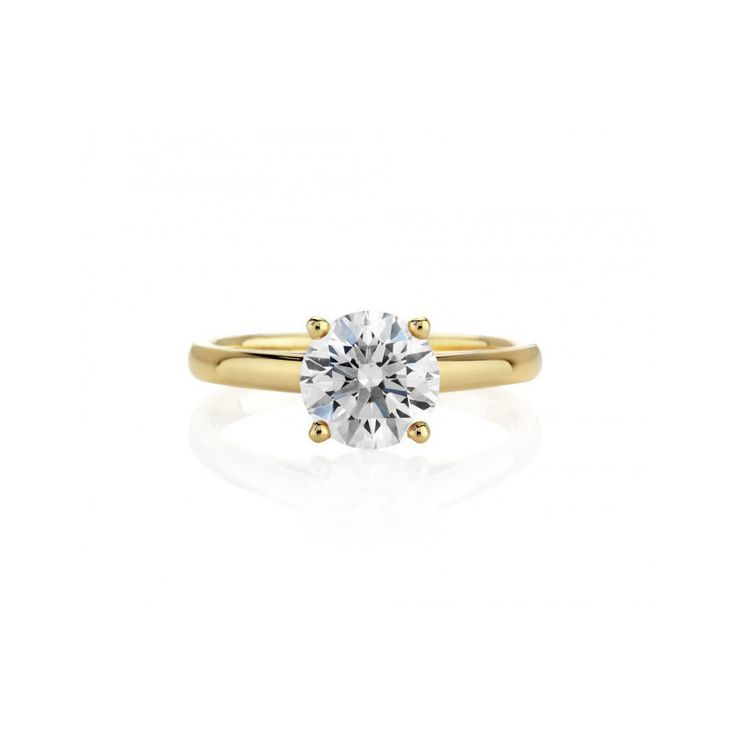 De Beers Classic Yellow Gold Solitaire Ring: www.stylemepretty...
