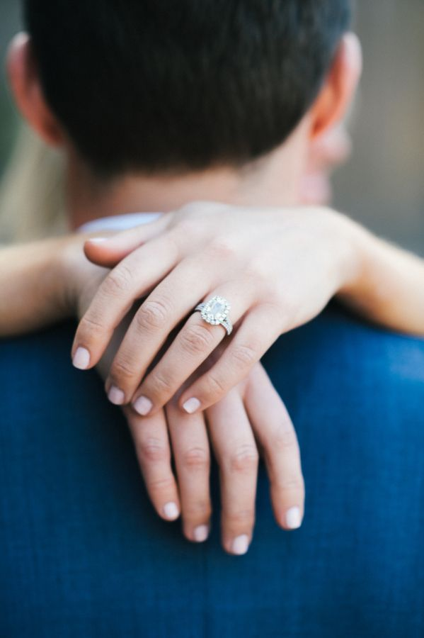 Gorgeous emerald cut halo engagement ring: www.stylemepretty... | Photography: S...