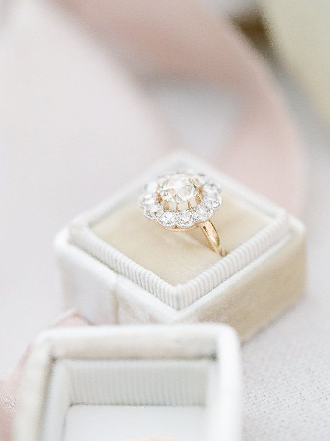 Gorgeous flower halo engagement ring: www.stylemepretty... | Photography: J. Lay...