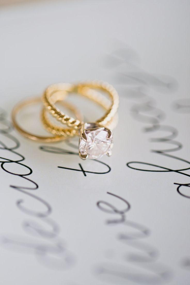 Intertwining gold band engagement ring: www.stylemepretty...