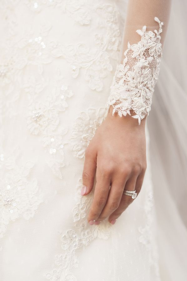 Lovely lace sleeve and a gorgeous rock: www.stylemepretty... | Photography: DeRa...