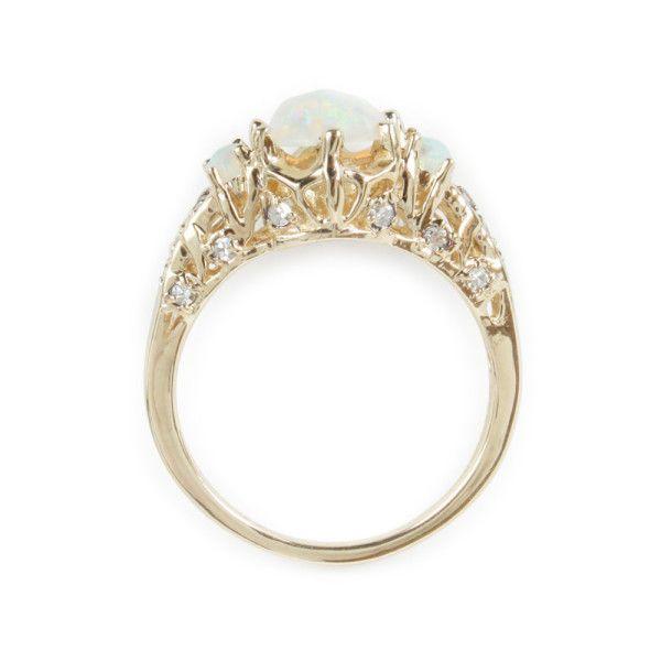 ManiaMania ceremonial opal ring: www.stylemepretty...