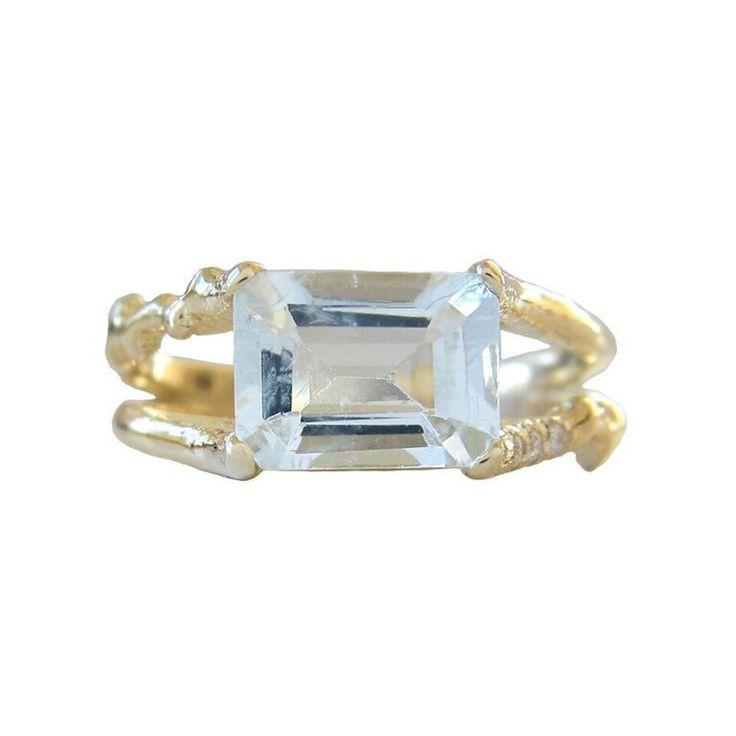 Misa Jewelry Aquamarine Floating Ring: www.stylemepretty...