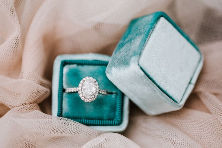 Oval cut diamond halo engagement ring: www.stylemepretty...   Photography: Annam...