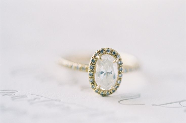 Yellow gold with a halo of gray diamonds: www.stylemepretty...