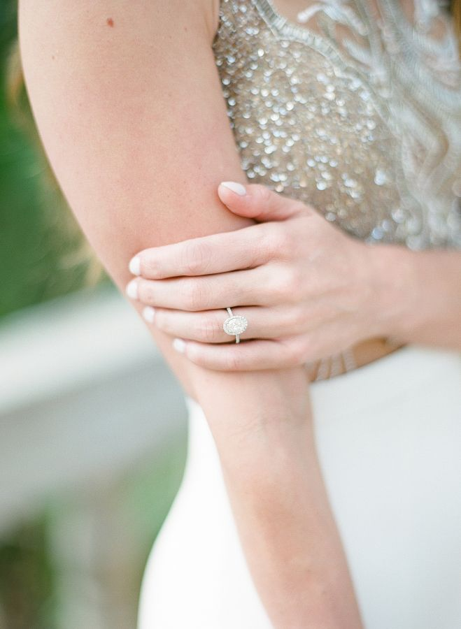 Oval halo engagement ring: www.stylemepretty... | Photography: Sophie Epton - ww...