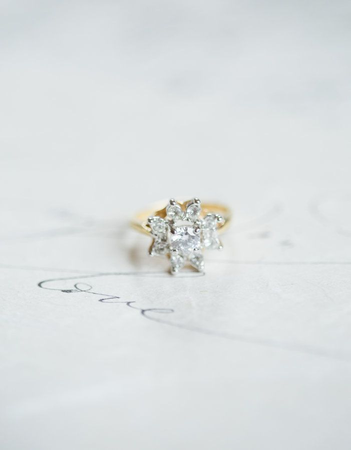 Pretty floral halo engagement ring: www.stylemepretty...   Photography: Katie Ni...