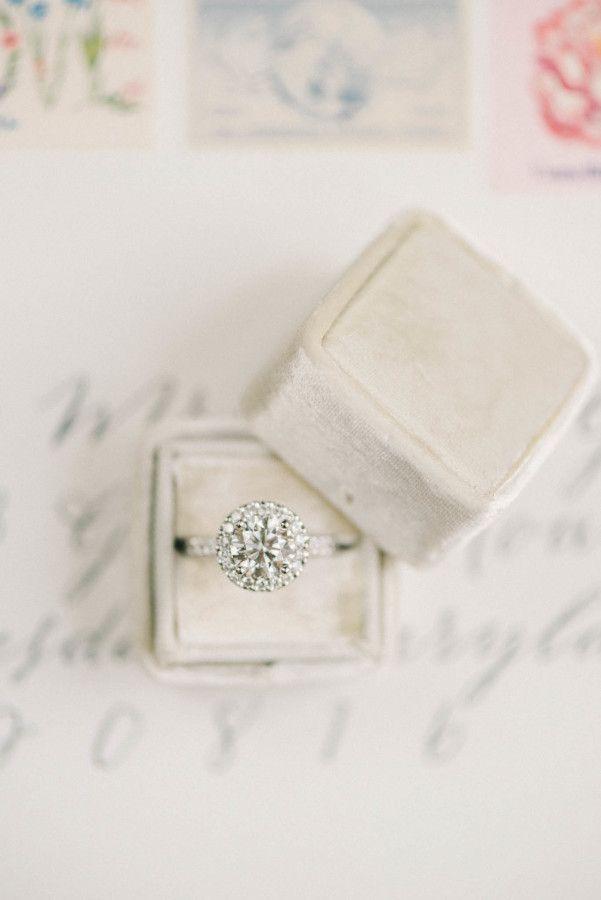Stunning halo engagement ring: www.stylemepretty...   Photography:Elizabeth Foga...