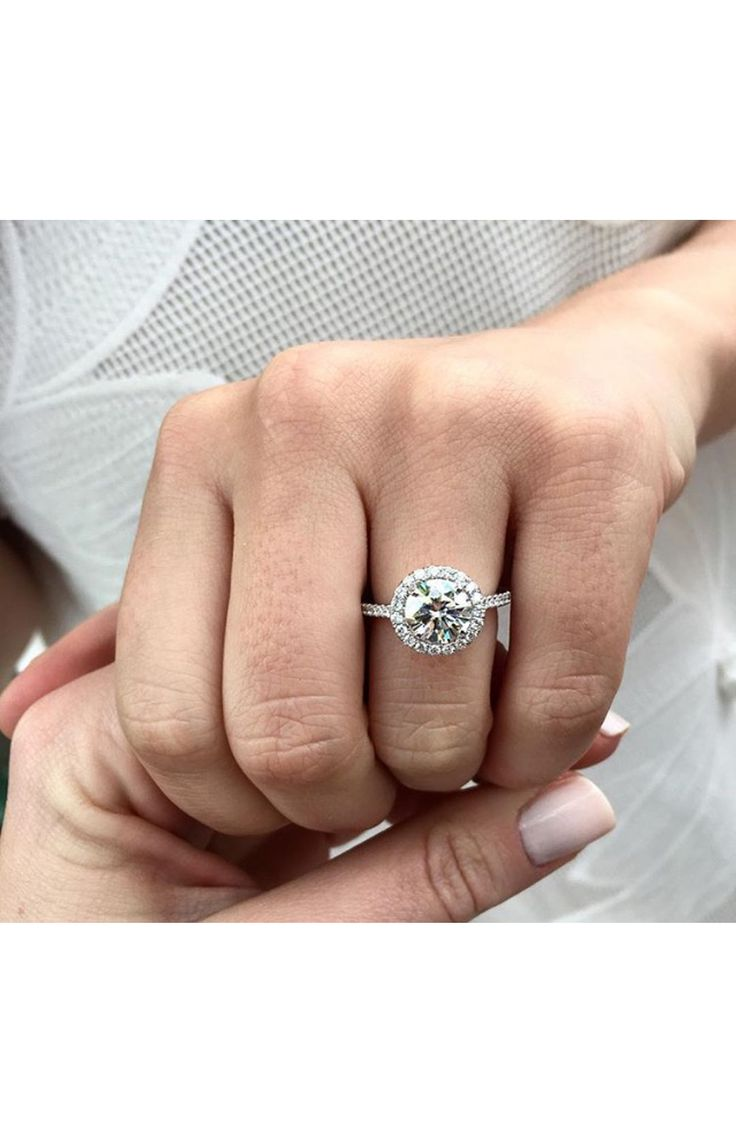 The prettiest halo engagement ring: www.stylemepretty...