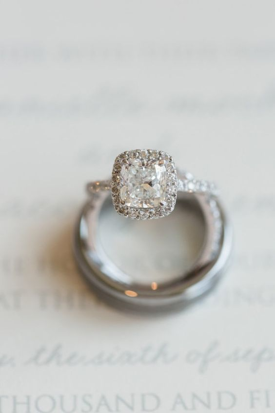 We're in love with this cushion cut halo engagement ring: www.stylemepretty... |...