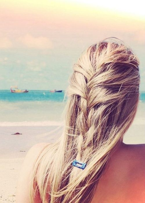 Summer style essential: Flowy hair and loose braids are two perfectly beachy hai...