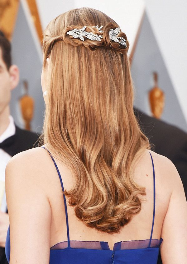 A diamond clip woven through a crown of braids adds an ethereal detail to Brie L...