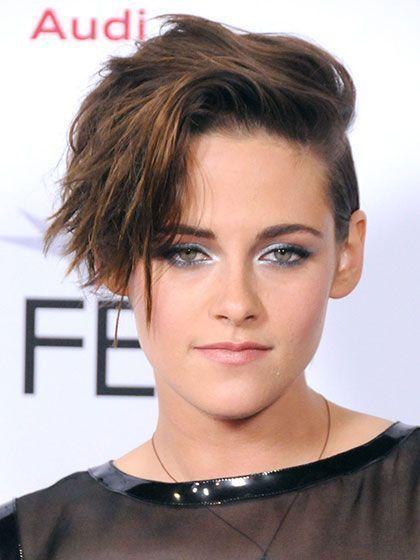 Kristen Stewart's Choppy, Layered Pixie hairstyle with shimmery silver eyeshadow...