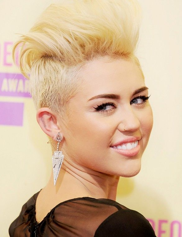 Miley Cyrus rocks short hair with shaved sides + big earrings