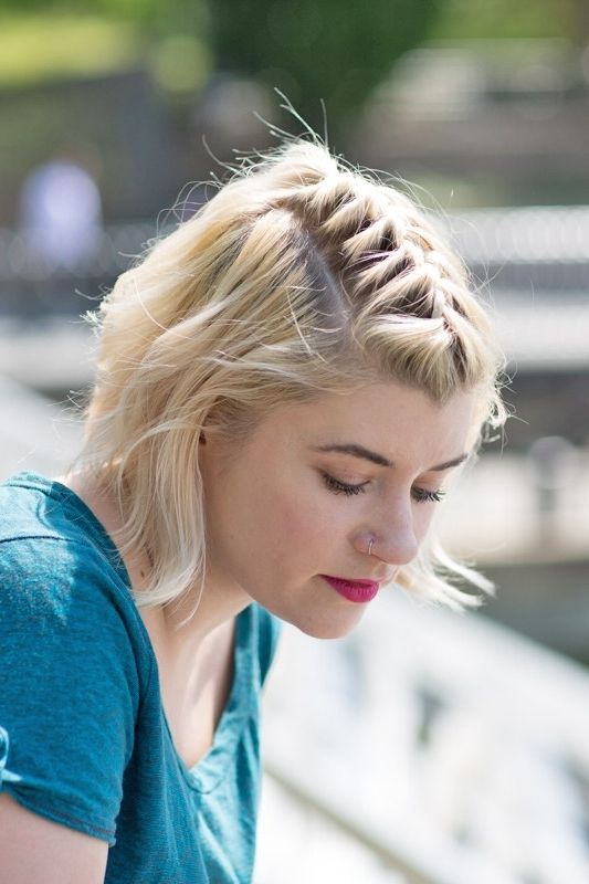 Short hair? Try a center braided part for an edgy look.