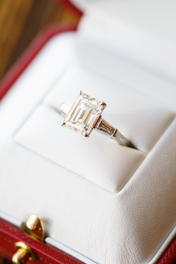 Emerald cut solitaire engagement ring: www.stylemepretty... | Photography: Brian...