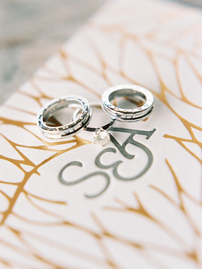 Engraved platinum wedding bands: www.stylemepretty... | Photography: Angga Perma...