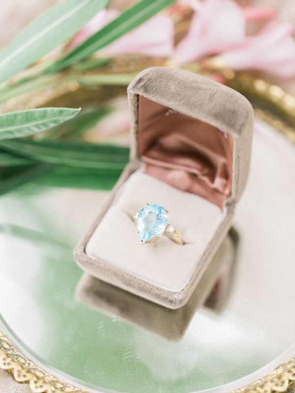 Gold ring with diamonds and an aquamarine stone: www.stylemepretty...