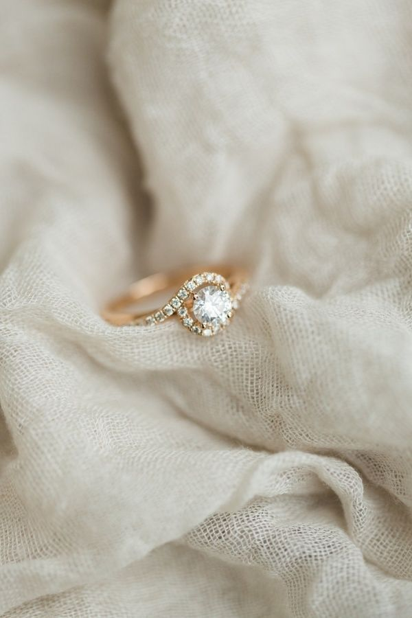 How pretty is this non-traditional halo engagement ring: www.stylemepretty...