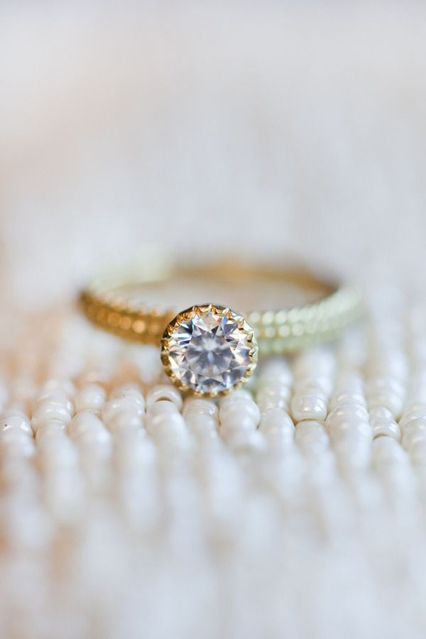 Round diamond and a gold textured band: www.stylemepretty...