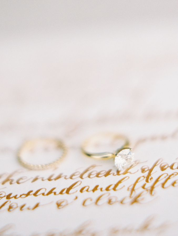Solitaire diamond gold band engagement ring: www.stylemepretty... | Photography:...