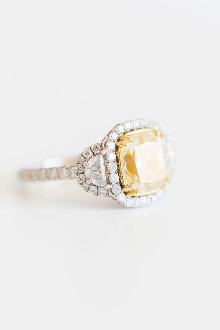 Unique canary yellow halo engagement ring for the bold bride: www.stylemepretty....