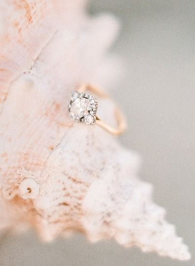Oval Cut Diamond, French Halo, & Gold Band: www.stylemepretty...