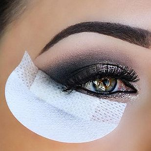 A box of adhesive shadow shields that catch eyeshadow fallout and also guide you...