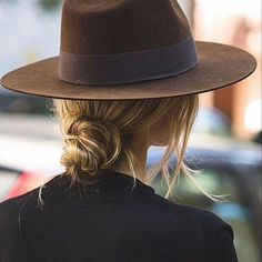 Try a knotted bun with a cool hat