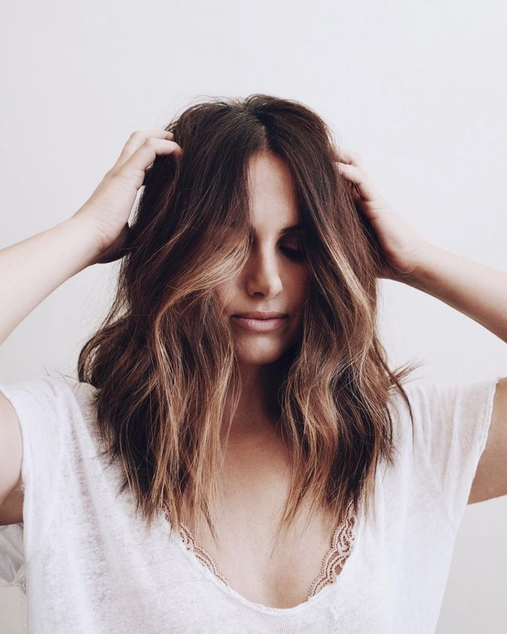 Lob haircut with angled layers and balayage highlights