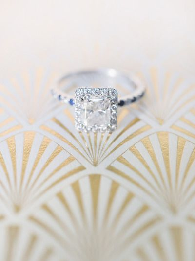 Emerald cut diamond & white diamond halo: www.stylemepretty...