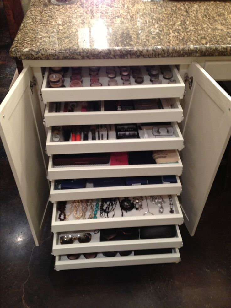 Shallow pullout drawers for makeup, jewelry & sunglasses storage; hidden by cabi...