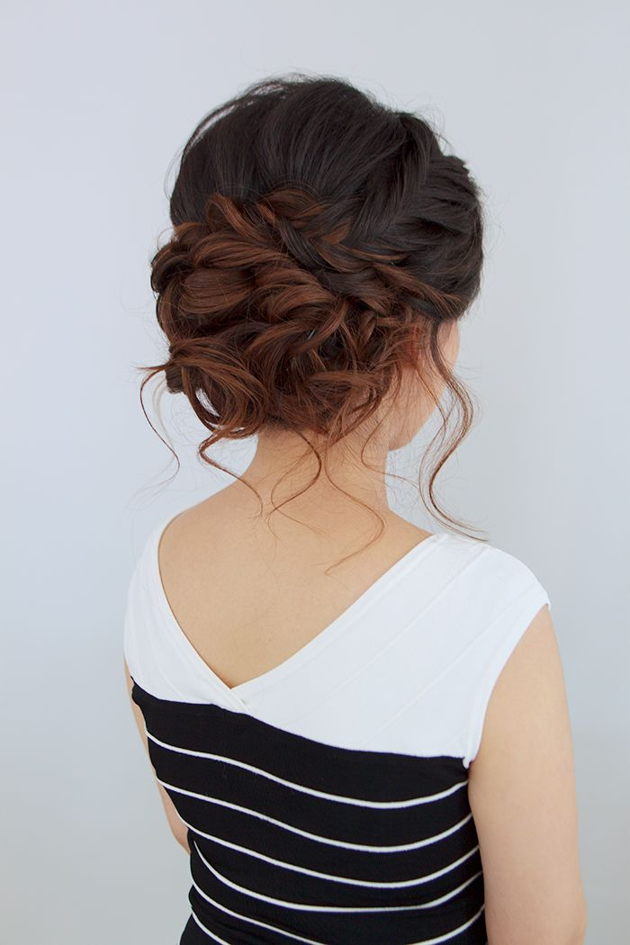 A stunning updo with wispy curls